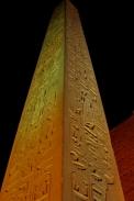 Closeup of illuminated red granite obelisk